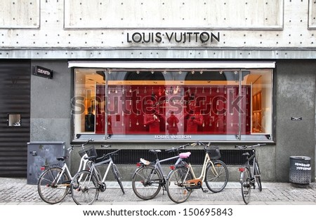 COPENHAGEN - MARCH 9: People visit Louis Vuitton store on March 9, 2011 in Copenhagen, Denmark. Forbes says that LV was the most powerful luxury brand in the world in 2008 with $19.4bn USD value. - stock photo