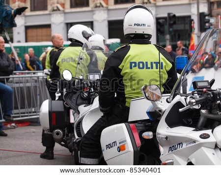 COPENHAGEN - SEPTEMBER 25: Unknown danish policemen secures the  2011 UCI road race championships in Rudersdal. September 25, 2011 in Copenhagen and Rudersdal, Denmark. - stock photo