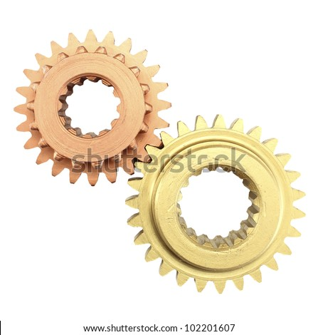 Copper and gold gear. - stock photo