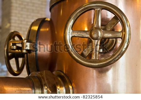 copper distillery tanks in brewery - stock photo