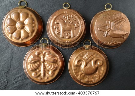 Copper molds for baking cakes. - stock photo