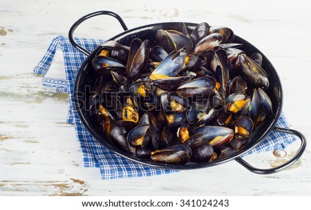 Copper pot of boiled mussels. Selective focus - stock photo