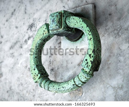 copper ring on the grave of the old cemetery - stock photo
