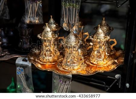 Copper Turkish tea glass at Istanbul market - stock photo