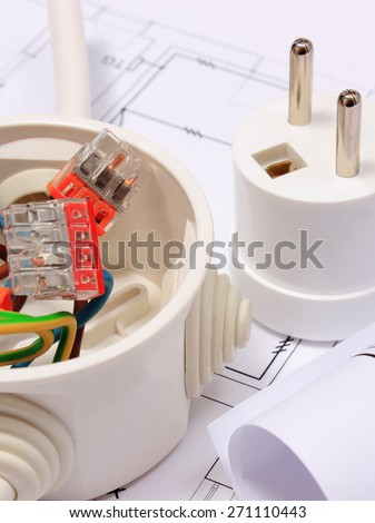 Copper wire connections in electrical box, rolls of electrical diagrams and electric plug on construction drawing of house, accessories for engineering work, energy concept - stock photo