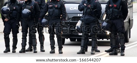 cops in the middle of the road during a control of law enforcement to stop drug dealers - stock photo
