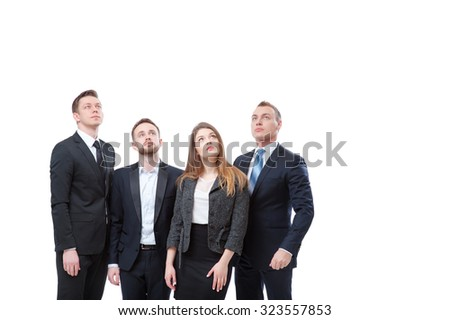 Copy space above. Group of interested business people looking up. Isolated on white. - stock photo