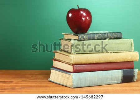 Copy Space Back to School Books and Apple With Chalkboard - stock photo