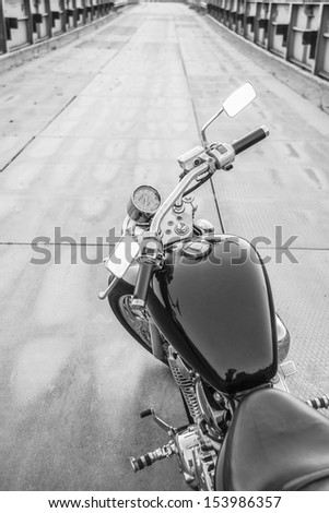 Copy space for inscription  The view over the handlebars of a speeding motorcycle as it races along a deserted highway. - stock photo