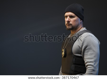 Copy space of undercover police officer with a badge and hat. - stock photo