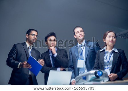 Copy-spaced image of a business team overthinking the project�¢??s development at the office - stock photo