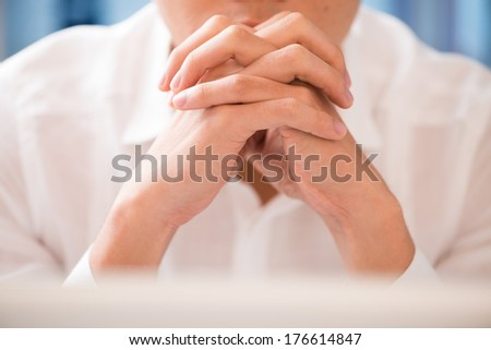 Copy-spaced image of a businessman contemplating at the office - stock photo