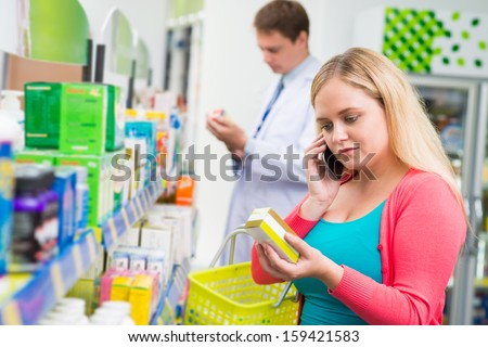 Copy-spaced image of a customer talking by phone while choosing the remedy on the foreground - stock photo