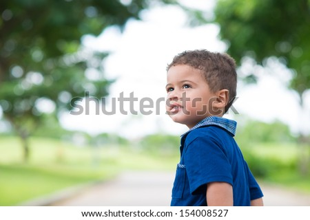 Copy-spaced image of a cute little boy in the park - stock photo