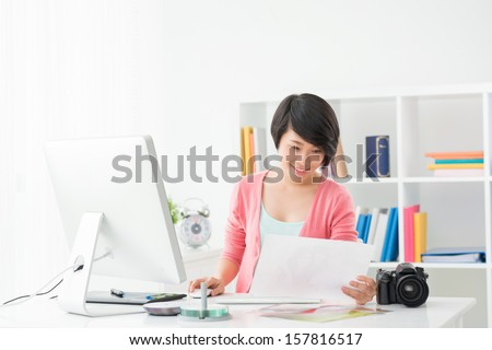 Copy-spaced image of a freelance photographer at work on the workplace - stock photo