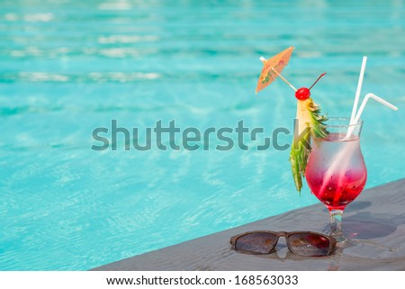 Copy-spaced image of a fresh glass of cocktail decorated with a pineapple slice  - stock photo