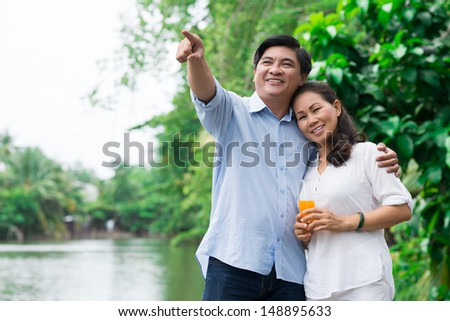 Copy-spaced image of a senior couple posing outside - stock photo