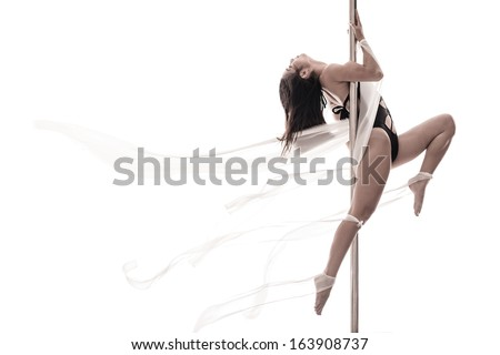 Copy-spaced image of a young pole dance woman over a white background - stock photo