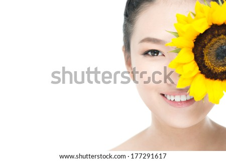 Copy-spaced portrait of a beautiful lady with a sunflower over a white background  - stock photo