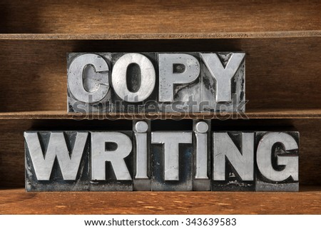copy writing phrase made from metallic letterpress type on wooden tray  - stock photo