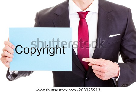 "Copyright concept - businessman showing card with the word ""copyright"" on it. Isolated on white background - stock photo"