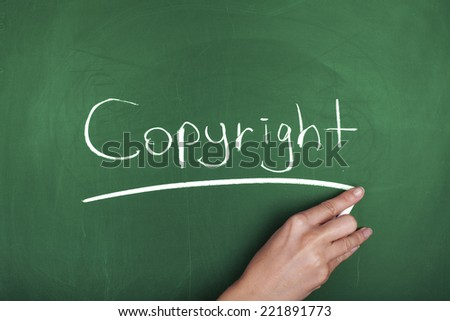 Copyright Hand Writing on Green Chalkboard - stock photo