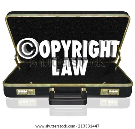 Copyright Law words and c symbol in 3d letters in a black leather briefcase of an attorney or lawyer in an infingement lawsuit against piracy - stock photo