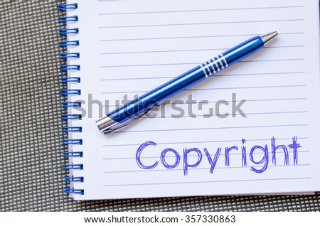 Copyright text concept write on notebook with pen - stock photo