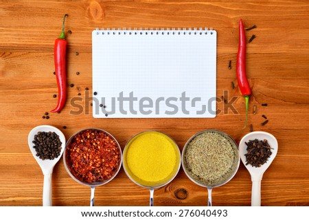 Copyspace food frame with notepad paper spices and cooking accesories - stock photo