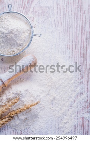 copyspace image sieve with white natural pin rolling pin and ears of rie on vintage wooden desk food and drink concept  - stock photo