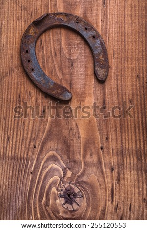 copyspace image the old rusty horseshoe on vintage wooden board happy concept  - stock photo