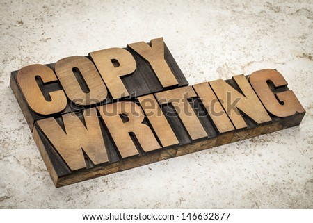 copywriting  word in vintage letterpress wood type on a ceramic tile background - stock photo