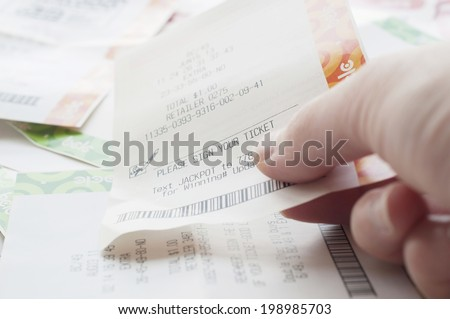 Coquitlam BC Canada - May 31, 2014 : Close up people holding a winning lottery ticket. The BC Lottery Corporation has provided government sanctioned lottery games in British Columbia since 1985.  - stock photo
