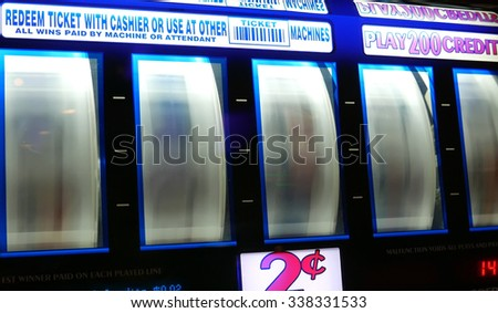 Coquitlam, BC, Canada - November 10, 2015 : Motion of spinning slot machine inside Hard Rock Casino  - stock photo
