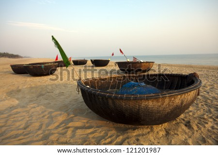 Coracles on beach, Hoi An, Vietnam - stock photo