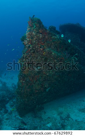 Coral encrusted bow section of an old tugboat sunk as an artificial reef in south east Florida. - stock photo