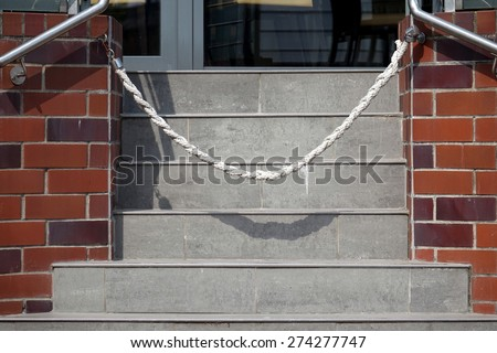 cord barrier prohibiting entrance via stairs - stock photo