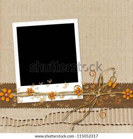 Cord of bast and flowers and polaroid photo frame on cardboard background - stock photo
