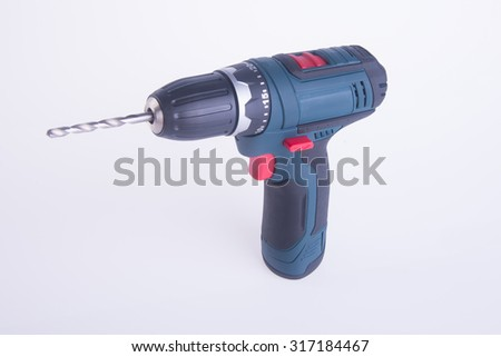 cordless drill. cordless drill on a background - stock photo