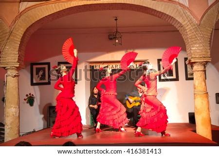 Cordoba, Spain - April 20: Flamenco dancers and singers performing at Tablao El Cardenal Flamenco Show on April 20, 2016 in Cordoba, Spain - stock photo