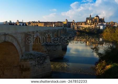 CORDOBA, SPAIN - DECEMBER 5, 2014: Roman bridge and  Cathedral of Cordoba - stock photo