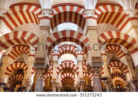 CORDOBA, SPAIN - MAY 15, 2014 Arches Pillars Mezquita Cordoba Spain.  Created in 785 as a Mosque, was converted to a Cathedral in the 1500.  850 Columns and Arches   - stock photo