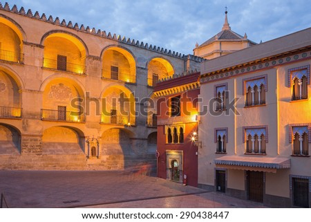 CORDOBA, SPAIN - MAY 25, 2015: The Cathedral east facade and Plaza del Triumfo at dusk. - stock photo