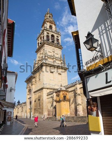 CORDOBA, SPAIN - MAY 26, 2015: The Cathedral tower and walls. - stock photo