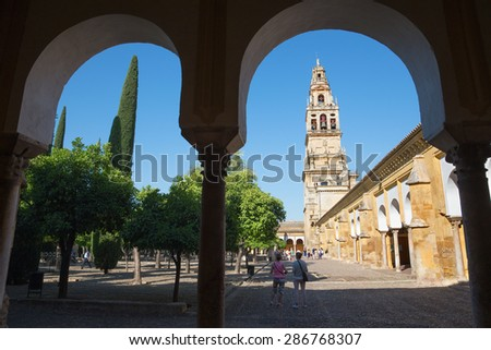 CORDOBA, SPAIN - MAY 28, 2015: The Cathedral tower from Orange tree Courtyard. - stock photo