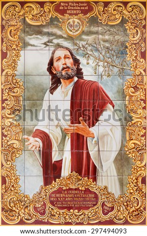 CORDOBA, SPAIN - MAY 26, 2015: The ceramic tiled, Jesus in Gethsemane garden on the facade of house on the Compas de San Francisco square by C. J. Soriano (2007). - stock photo