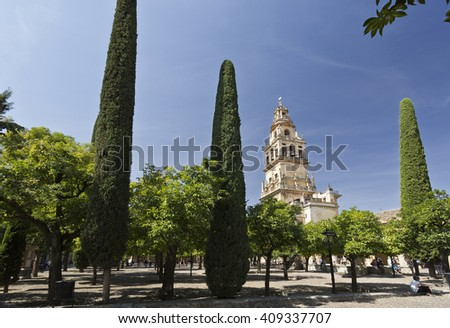 CORDOBA, SPAIN - September 10, 2015: The Bell Tower, also called the Tower of Alminar, seen from the Courtyard of the Orange Trees of the Mosque-Cathedral on September 10, 2015 in Cordoba, Spain - stock photo