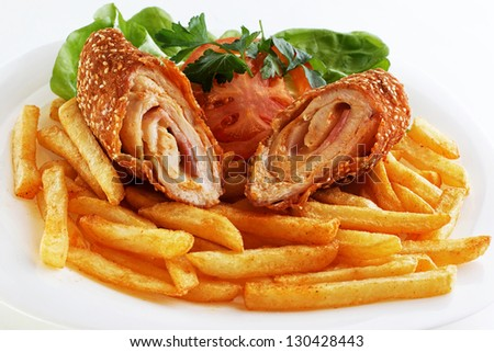 Cordon bleu and french fries served on white plate - stock photo
