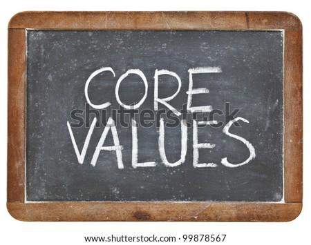 core values phrase - white chalk handwriting on a vintage slate blackboard, isolated - stock photo