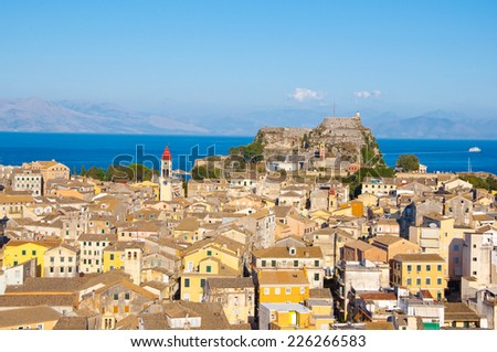 CORFU-AUGUST 22: Panoramic view of Corfu city with the Old Fortress on the background as seen from the New Fortress on August 22, 2014 on Corfu island, Greece. - stock photo